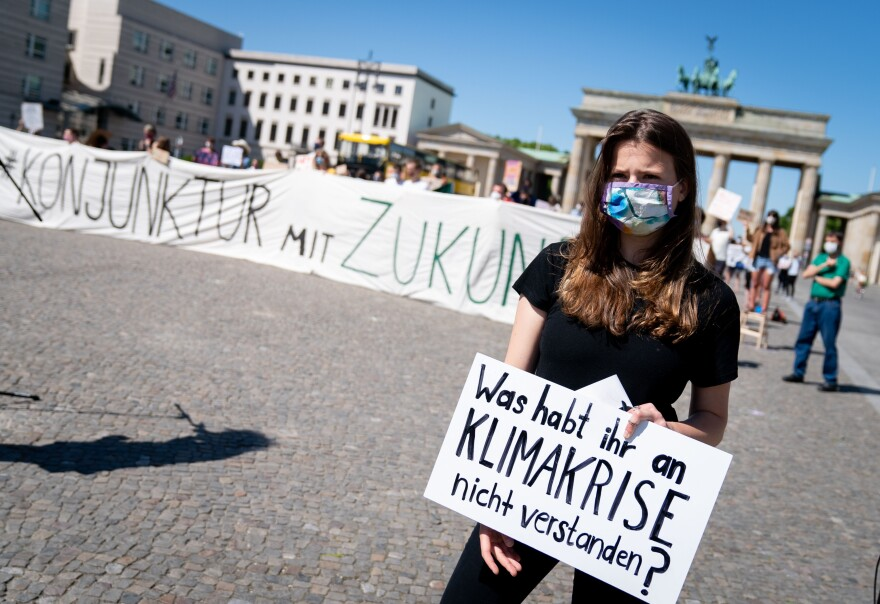 Luisa-Marie Neubauer of Fridays for Future takes part in a demonstration in front of the Brandenburg Gate in Berlin on June 2. The protest took place while government leaders discussed economic stimulus and other strategies in the fight against the coronavirus.