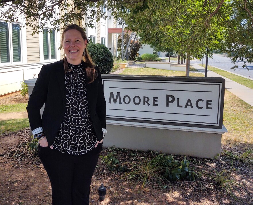Liz Clasen-Kelly, CEO of Roof Above, outside Moore Place, supportive housing apartments in Charlotte's North End.