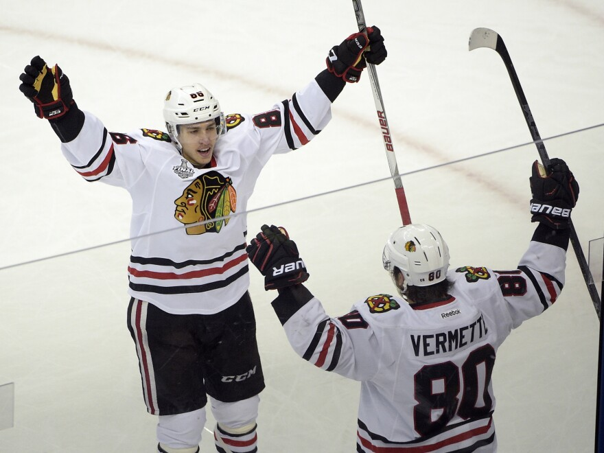 Chicago Blackhawks center Antoine Vermette (80) of Canada, celebrates his game-winning goal with Teuvo Teravainen of Finland (86), against the Tampa Bay Lightning during the third period in Game 1 of the NHL hockey Stanley Cup Final on Wednesday in Tampa, Fla.