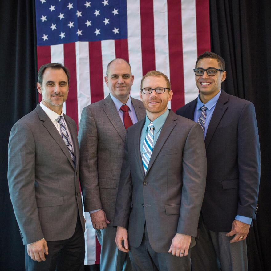 Dave Manning (left) and three other veterans who are studying to become physician assistants at the University of North Carolina in Chapel Hill.