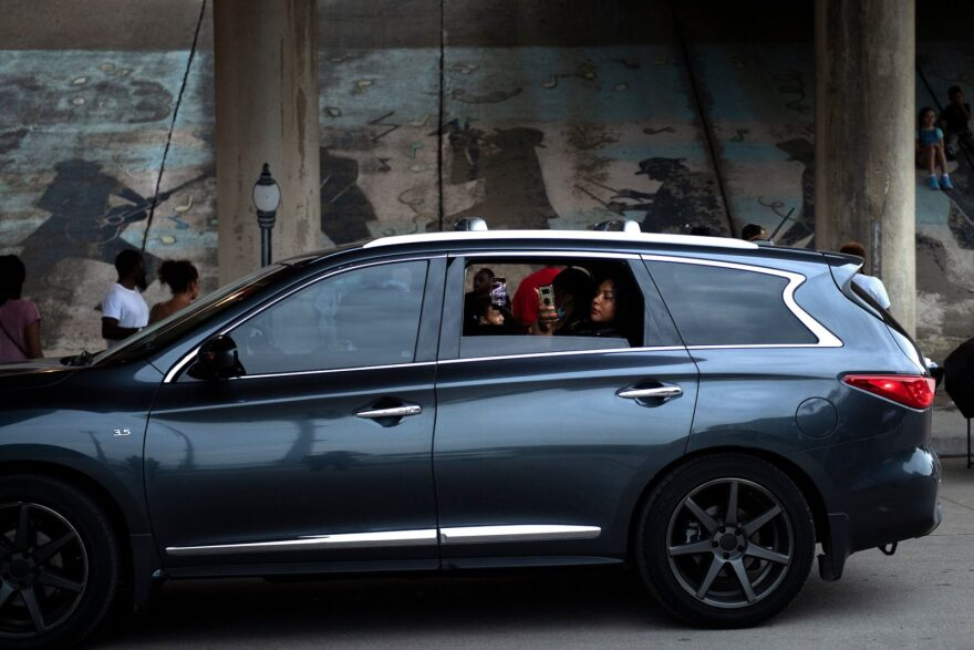 People drive under a highway overpass over the remains of Black Wall Street in the Greenwood District during Juneteenth celebrations in Tulsa, Oklahoma.