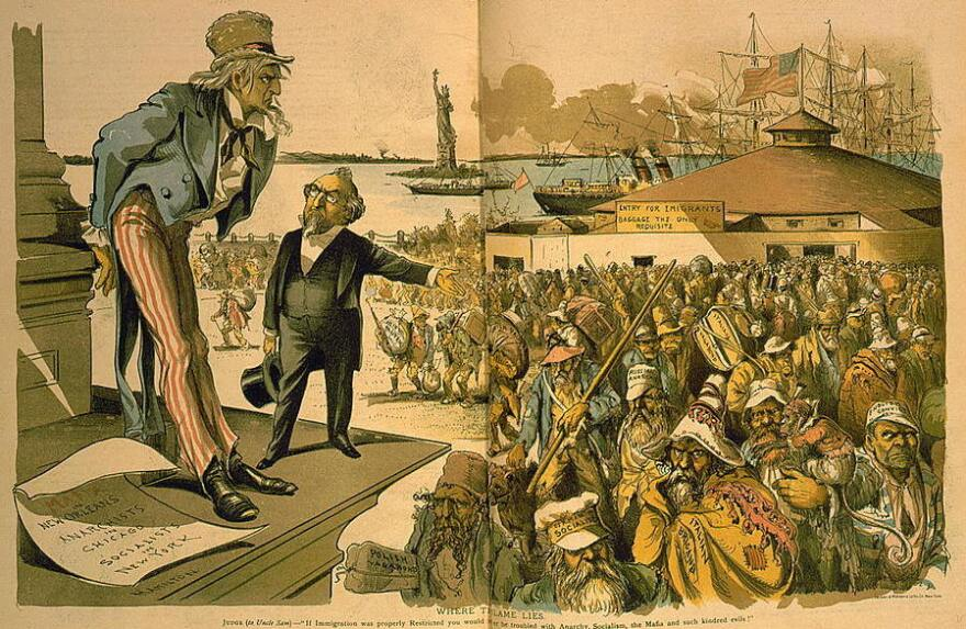 "A cartoon, published in 1891, titled ""Where the Blame Lies."" shows a man gesturing toward a crowd of immigrants — including the ""German socialist,"" ""Italian brigand"" and ""English convict."" The gesturing man tells a sagging Uncle Sam: ""If Immigration was properly Restricted you would no longer be troubled with Anarchy, Socialism, the Mafia and such kindred evils!"""