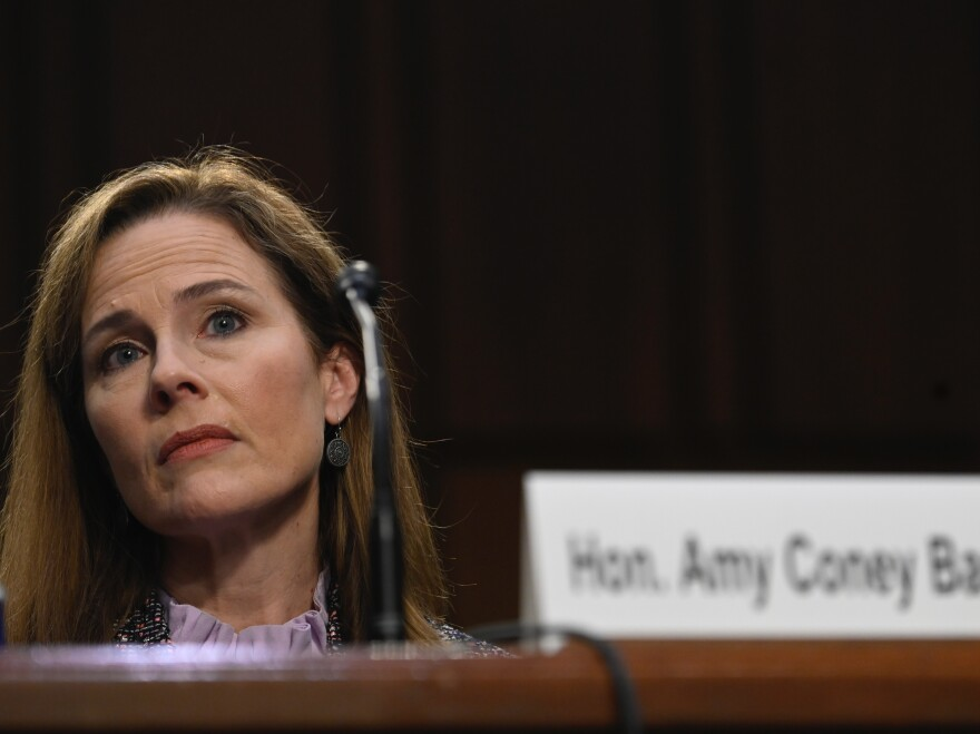 Supreme Court nominee Amy Coney Barrett testifies before the Senate Judiciary Committee on Oct. 14, 2020. On Thursday, the committee voted to advance her nomination to the full Senate for a confirmation vote.