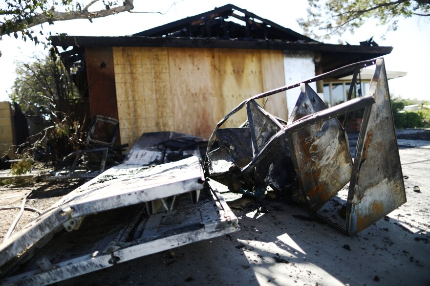 Charred items sit in front of a home that caught fire in Ridgecrest, Calif., after a 6.4 magnitude earthquake Thursday.