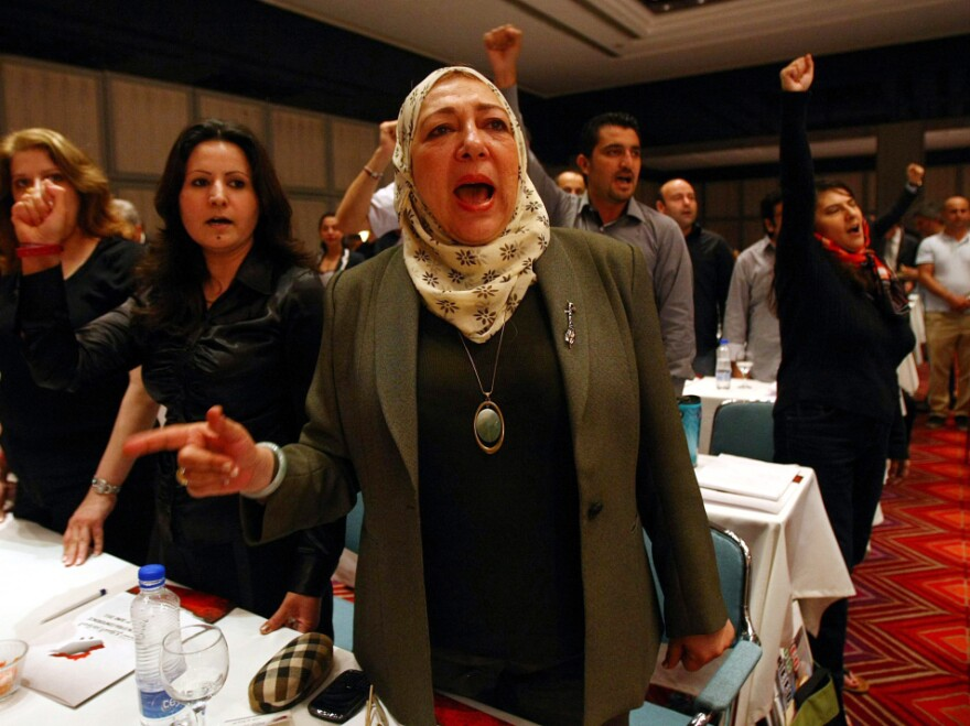 Syrian opposition activists chant in Antalya, Turkey, during the opening session of a three-day meeting to discuss democratic change and voice support for the revolt against President Assad's regime.