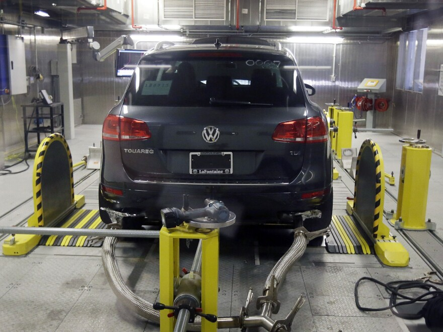 A Volkswagen Touareg diesel is tested in the Environmental Protection Agency's cold temperature test facility in Ann Arbor, Mich. The EPA has charged that the emissions scandal goes further than first acknowledged by the company.