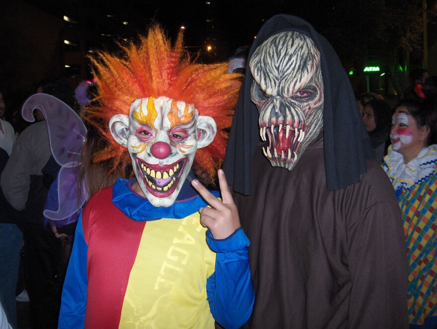 two guys in Halloween costumes on 6th Street