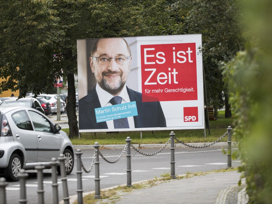 "An election poster with the message ""It is time"" shows Social Democratic Party candidate Martin Schulz."