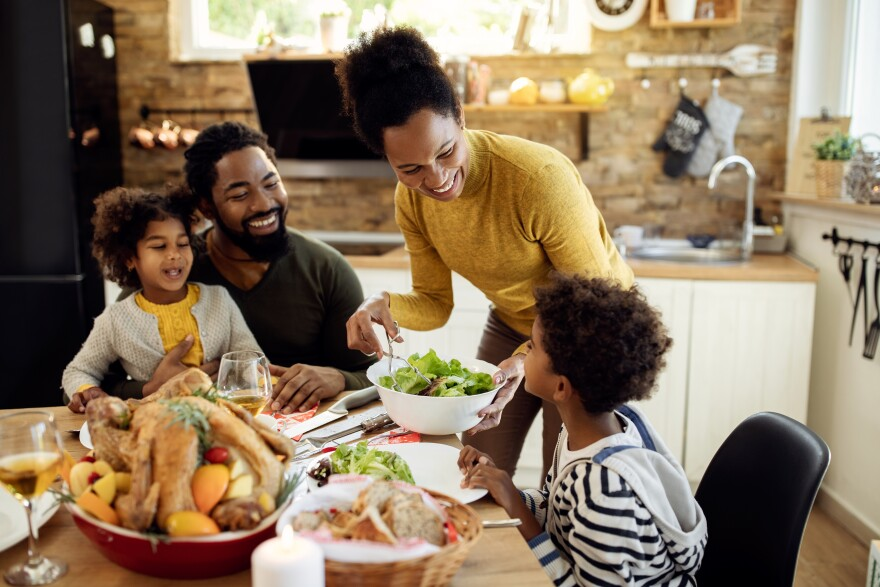 A family enjoys a Thanksgiving meal together.