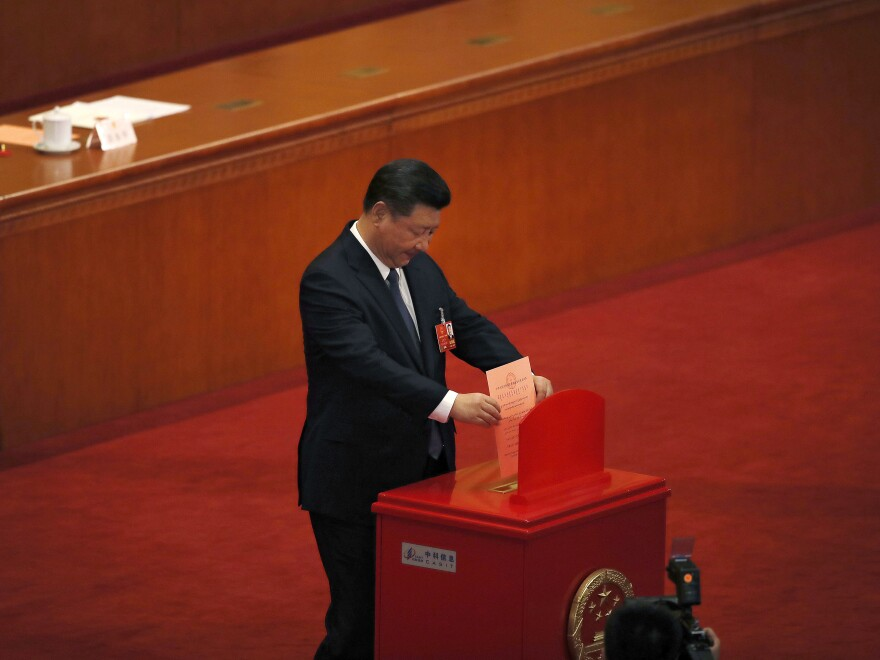 Chinese President Xi Jinping casts his vote for an amendment to China's constitution that abolishes term limits on the presidency, during a plenary session of the National People's Congress at the Great Hall of the People in Beijing on Sunday.