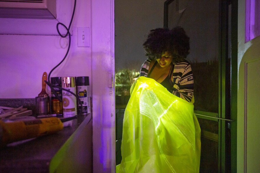 Women of Wakanda member Sonita Singh works with her fiber optic embedded cloth that she will attach to her costume.