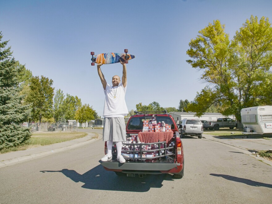 "Nathan Apodaca, whose TikTok video longboarding to Fleetwood Mac's ""Dreams"" has catapulting him to viral fame. Here, he is standing in the pickup truck donated to him by Ocean Spray. In his video, Apodaca sips a bottle of Ocean Spray's Cran-Raspberry juice."