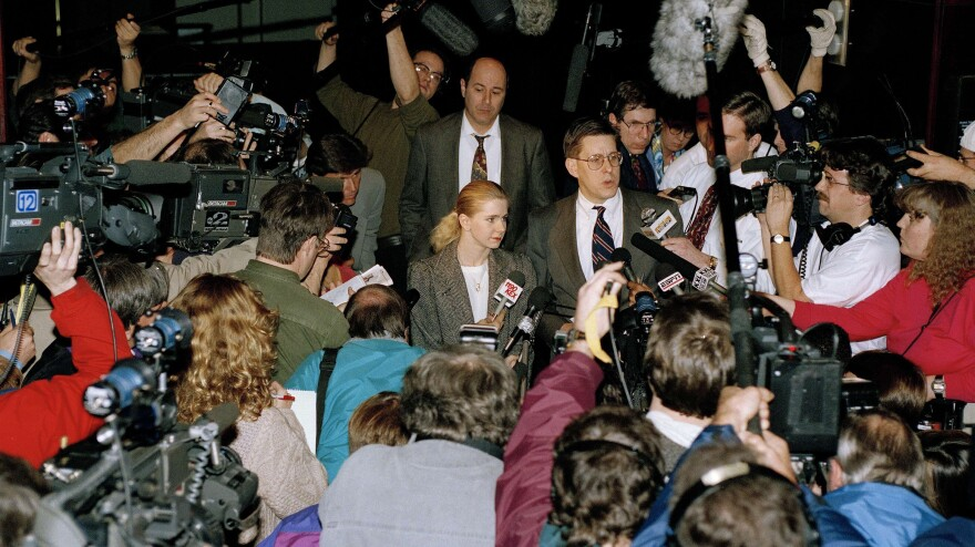 Photographers and reporters beset Harding and her lawyer outside the district attorney's office in Portland, Ore., in 1994, after the attack on Kerrigan.