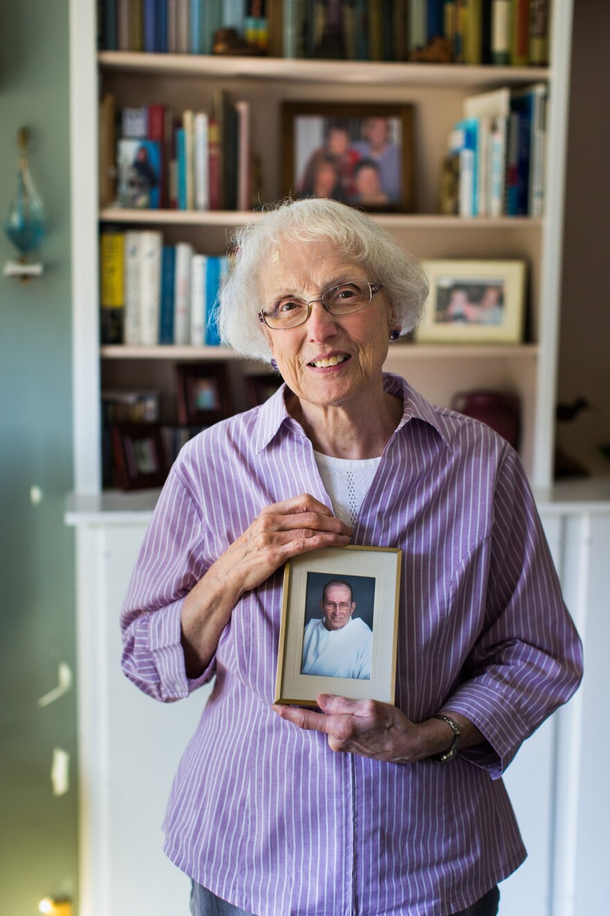 Eve Farrell holds a portrait of her husband, Daniel, in her Port Angeles, Wash., home. He died in January of chronic obstructive pulmonary disease.