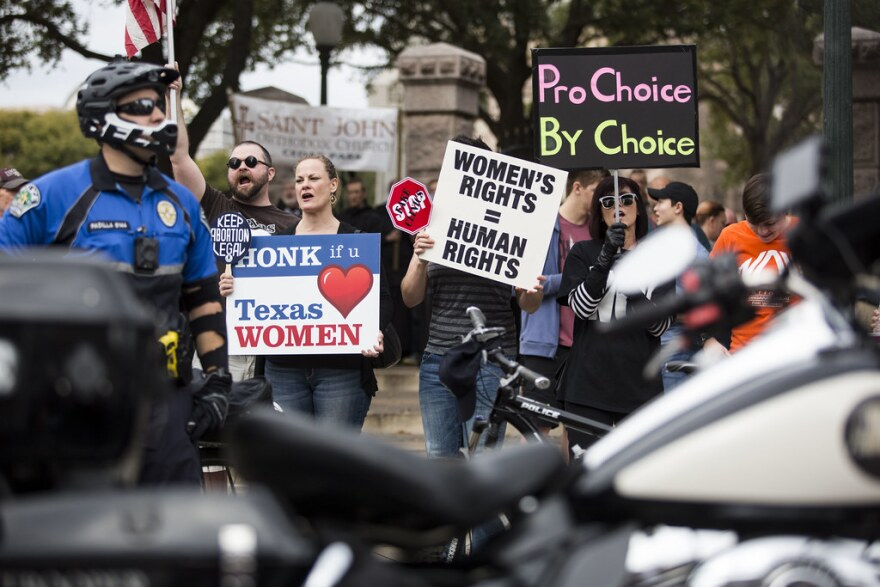 Abortion-rights supporters confront anti-abortion protesters at a Rally for Life in downtown Austin in 2018.