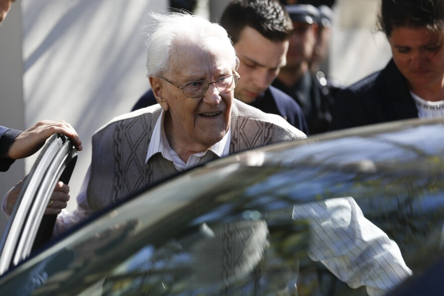 Former SS guard Oskar Groening, now 93, enters a car after the first day of his trial in Lueneburg, Germany, on Tuesday. He faces 300,000 counts of accessory to murder, in a case that tests the argument that anyone who served at a Nazi death camp was complicit in what happened there.