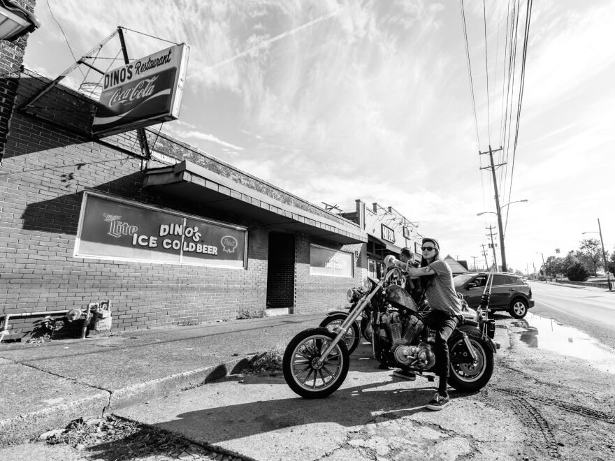 A member of the Blackbirds, one of Nashville's resurgent motorcycle clubs, stops outside Dino's, Nashville's oldest dive bar. The bar is family-friendly until 8 p.m.; it's just plain friendly after that.