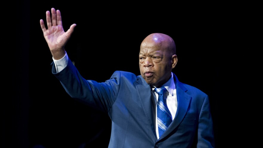 Rep. John Lewis waves during the swearing-in ceremony of Congressional Black Caucus members in January.