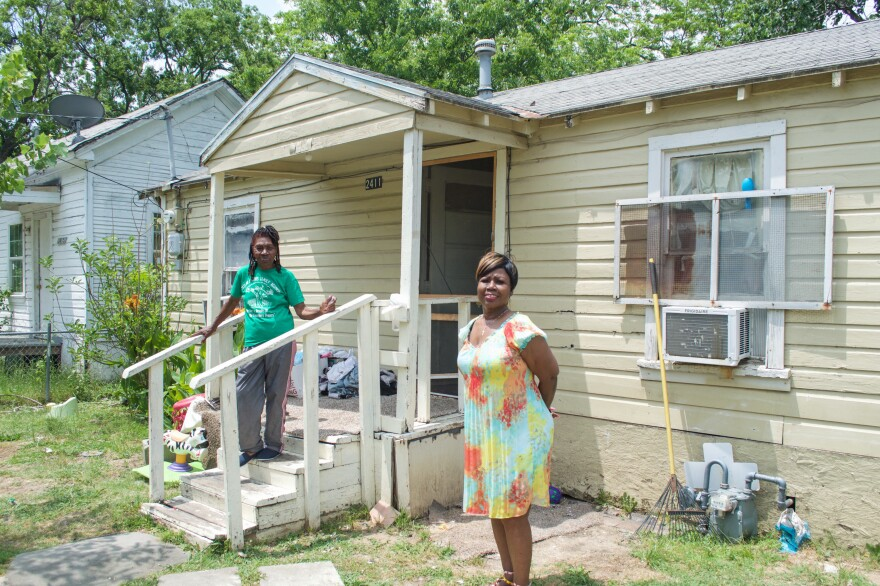 Pearlie Mae Brown (left) and her daughter, Pearline Brown Harper, in front of Pearlie Mae's home in West Dallas.