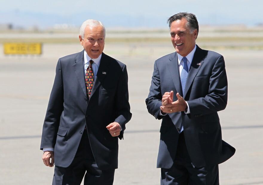 Mitt Romney (right) with Sen. Orrin Hatch, R-Utah, who met him on the tarmac at Salt Lake International Airport in June 2012.