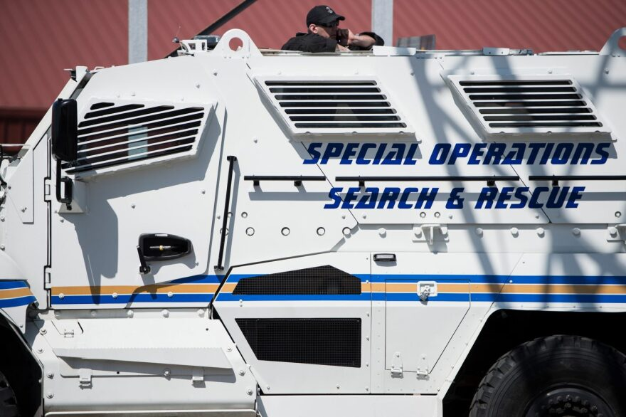 A police officer in a mine resistant vehicle waits for a labor march in Memphis, Tennessee, on the 50th anniversary of the assassination of Martin Luther King Jr in 2018.