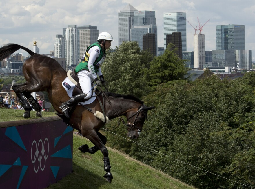 Sam Griffiths of Australia, and his horse Happy Times, compete in the cross country phase of the equestrian eventing competition in London's Greenwich Park.