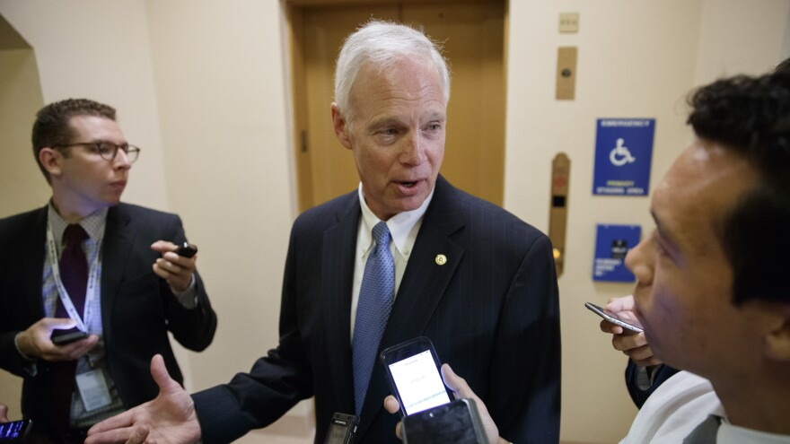 Sen. Ron Johnson, R-Wis., talks to reporters in July. On Wednesday, Johnson became the first GOP senator to come out against the current tax plan.