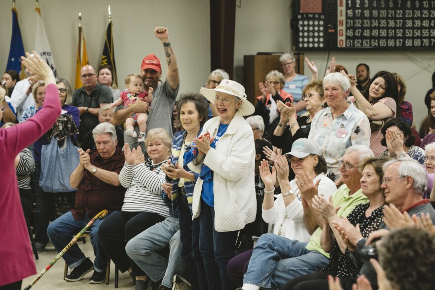 Doris Adams (center) cheers at Warren's campaign stop at the AMVETS veterans post in Chillicothe, Ohio, on May 10. Chillicothe is a rural town in southern Ohio.