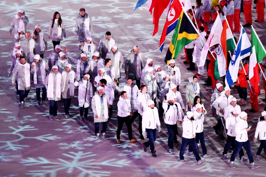 Members of Olympic Athletes from Russia teams parade in. The athletes had to compete under a neutral flag after the nation's official team was banned from the games.