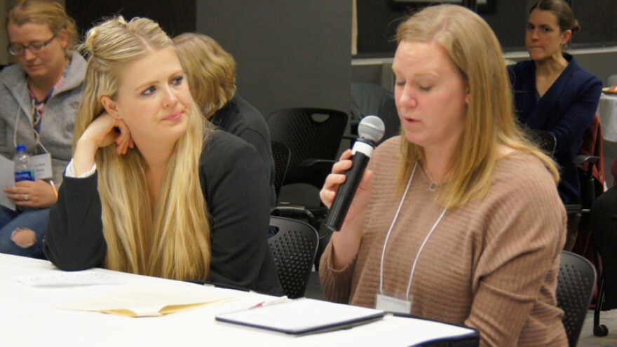 Erin Krohn, right, and Kate Swenson testify in a mock hearing as part of their training. Later, each went to the Minnesota state capitol and told their lawmakers about the home care and Medicaid services their families rely upon.