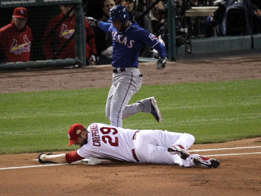 <p>A cool out: Pitcher Chris Carpenter of the St. Louis Cardinals tags first base for an out as Elvis Andrus of the Texas Rangers reaches the base.</p>