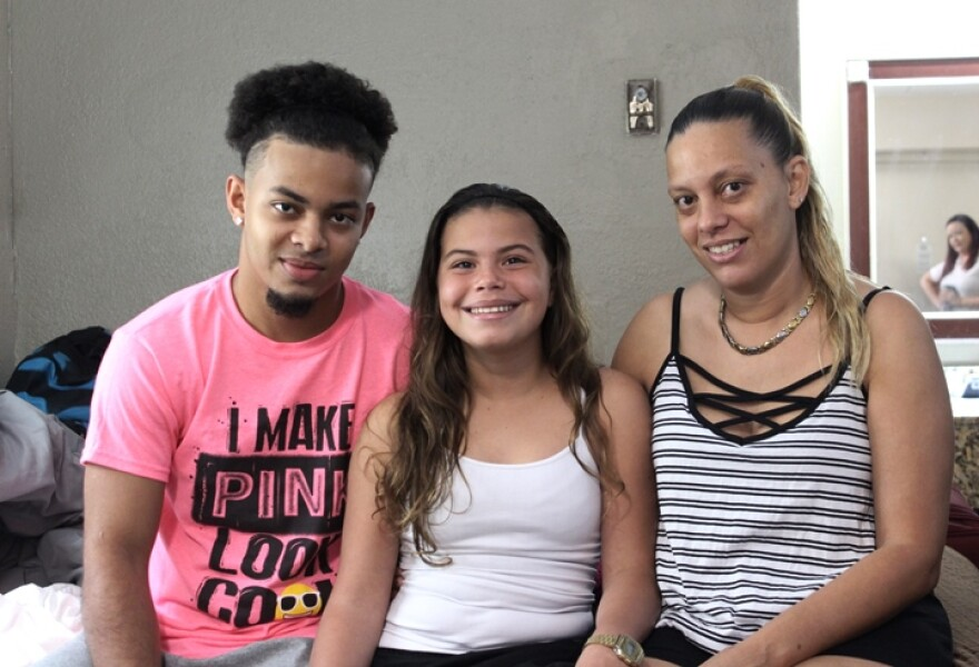 Through a federal grant, the non-profit Catholic Charities is providing motel rooms and rental assistance to displaced Puerto Rican families in Tampa Bay such as Lillian Vasquez, right, and her two children Illianis, center, and Melvin, left.