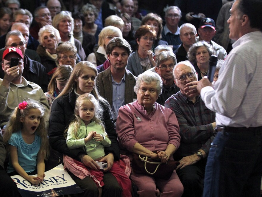 Former Massachusetts Gov. Mitt Romney campaigns Sunday in Council Bluffs, Iowa.