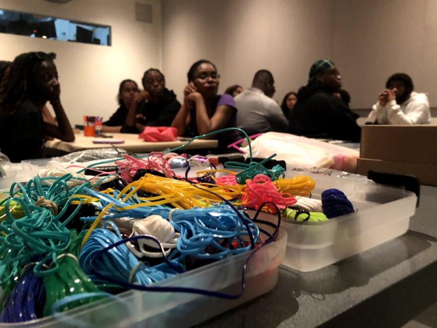 Plastic string foreground students background Wolfsonian zines.jpg