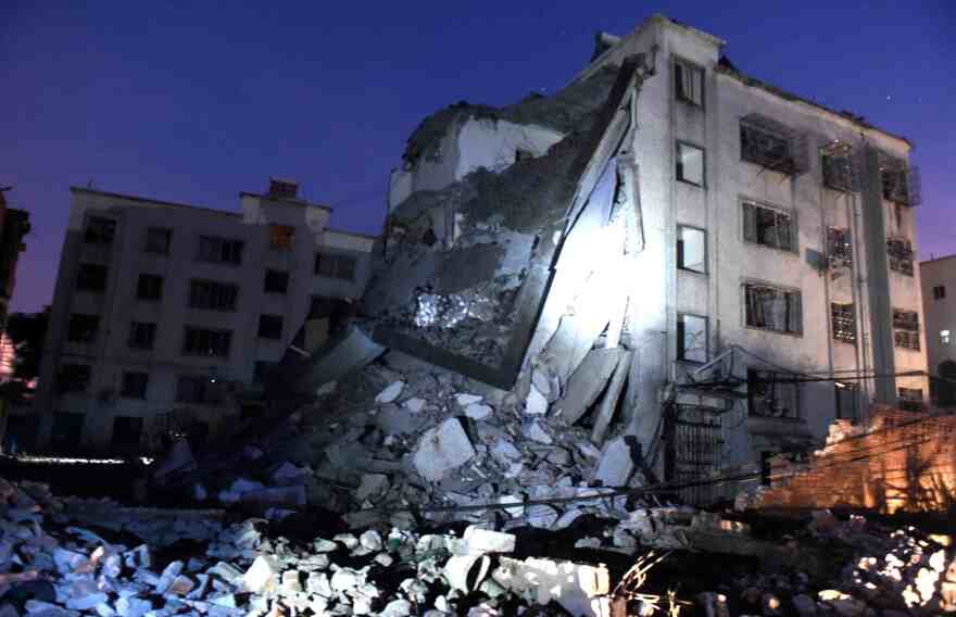Damaged buildings are seen in Liucheng County in south China's Guangxi region. The death toll from 17 suspected mail bombs in the area rose to seven Wednesday afternoon.