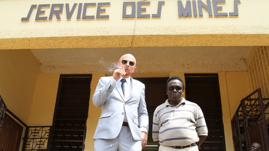 Mads Brugger, in character as diplomat Mads Cortzen, conferences with various members of the Central African Republic's government.