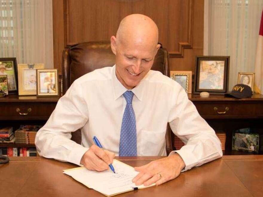 Gov. Rick Scott signs the 2015-16 budget Tuesday in Tallahassee.