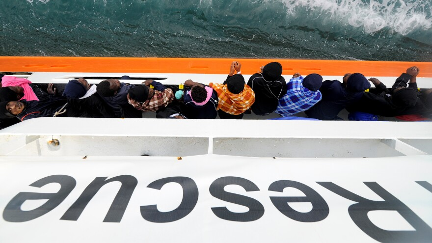 Migrants wait to disembark from the rescue ship Aquarius in the Sicilian harbor of Catania, Italy, on May 27. This past weekend the ship picked up more migrants, but was turned away from ports in Sicily and the nearby country of Malta. Now it will head for Spain instead.