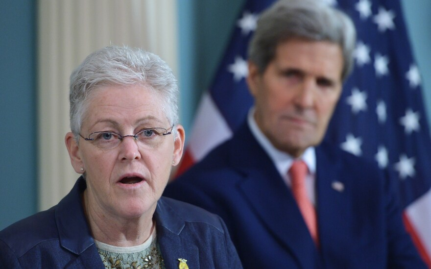 Then-Environmental Protection Agency Administrator Gina McCarthy speaks during a 2015 signing ceremony for an air quality agreement as then-Secretary of State John Kerry looks on. The two will be back together working on climate issues in the Biden administration.