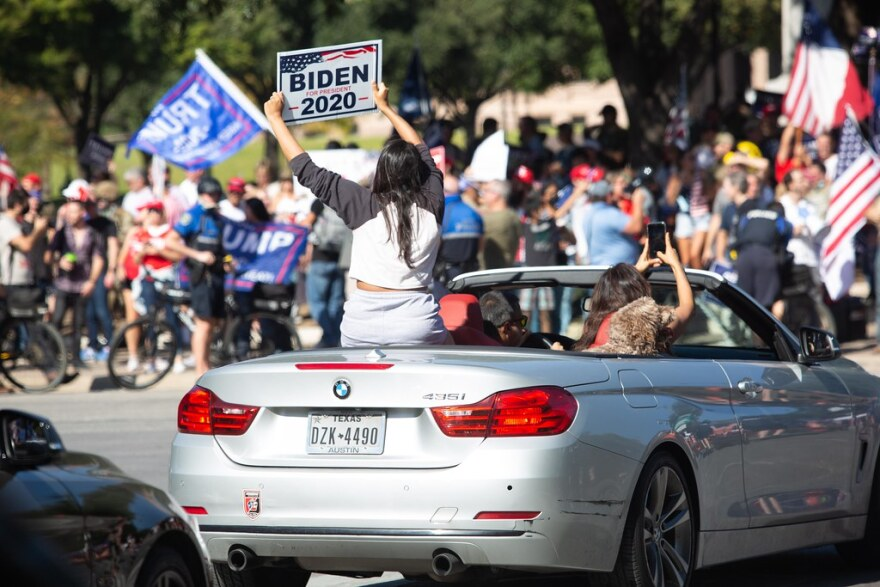 Supporters of President-elect Joe Biden drive past Donald Trump supporters on Congress Avenue after the election was called Saturday.