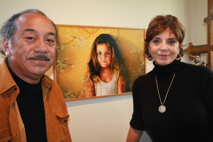 Jody and  Reynaldo Terrazas stand in front of a painting of their oldest daughter. The  Terrazases have lived in Oakland's San Antonio neighborhood for more than 40 years and  raised two girls there.