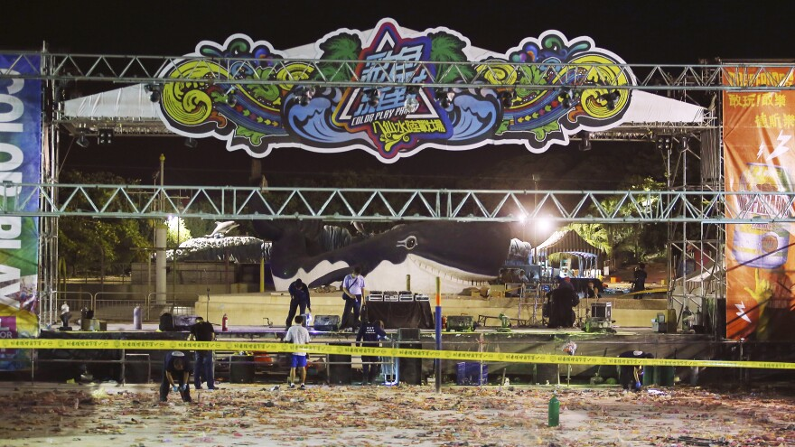 Police investigators inspect the stage area after an accidental explosion during a music concert at the Formosa Water Park in New Taipei City, Taiwan, early Sunday. The resulting fire injured more than 500 concert-goers.