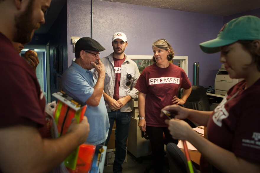 Juan Parras, left, the executive director of Texas Environmental Justice Advocacy Services, or TEJAS, talks with Kahler Stone and Jennifer Horney, part of a group from Texas A & M University who do soil and water testing in the Manchester neighborhood.