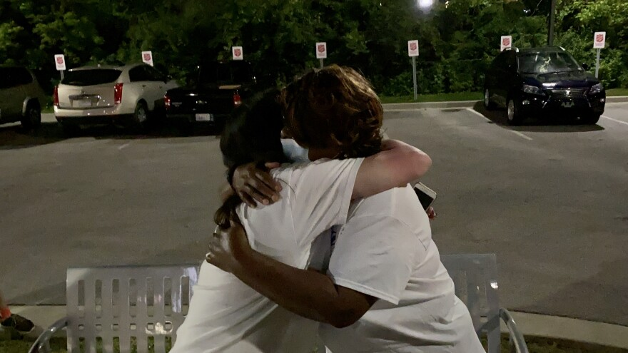 Jones embraces Heather Robinett at her victory party in Ferguson on June 3, 2020. Jones defeated Robinett to become Ferguson's mayor by about 100 votes.