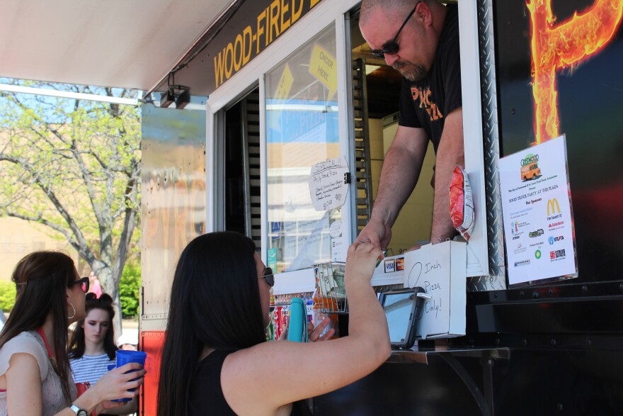 Angelina Livia, ordering from Pyro Pizza's food truck, came to the event to spend time with her childhood friend Jamie Becker, with whom she often went shopping at Crestwood mall.