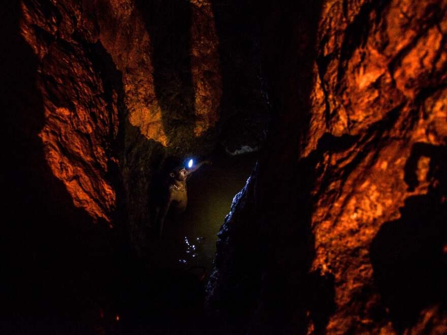 A miner looks for gold at La Culebra gold mine in El Callao, which sits in Venezuela's Orinoco Mining Arc.