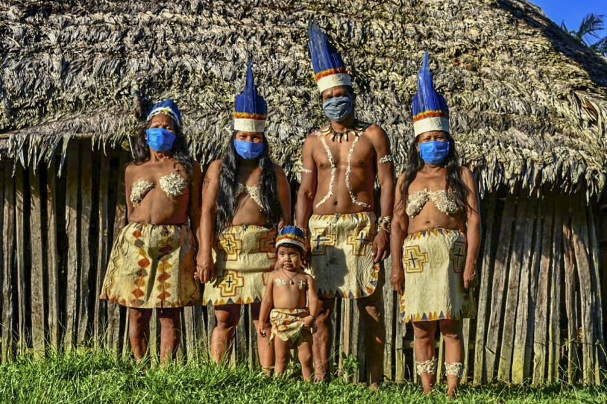 Colombian Huitoto Indigenous people pose for a photograph in Leticia.