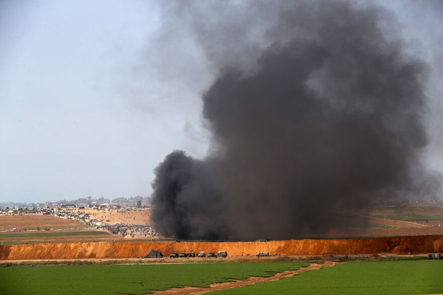 Smoke billows from a protest in Gaza on Friday, as seen from the southern Israeli kibbutz of Mefallesim.