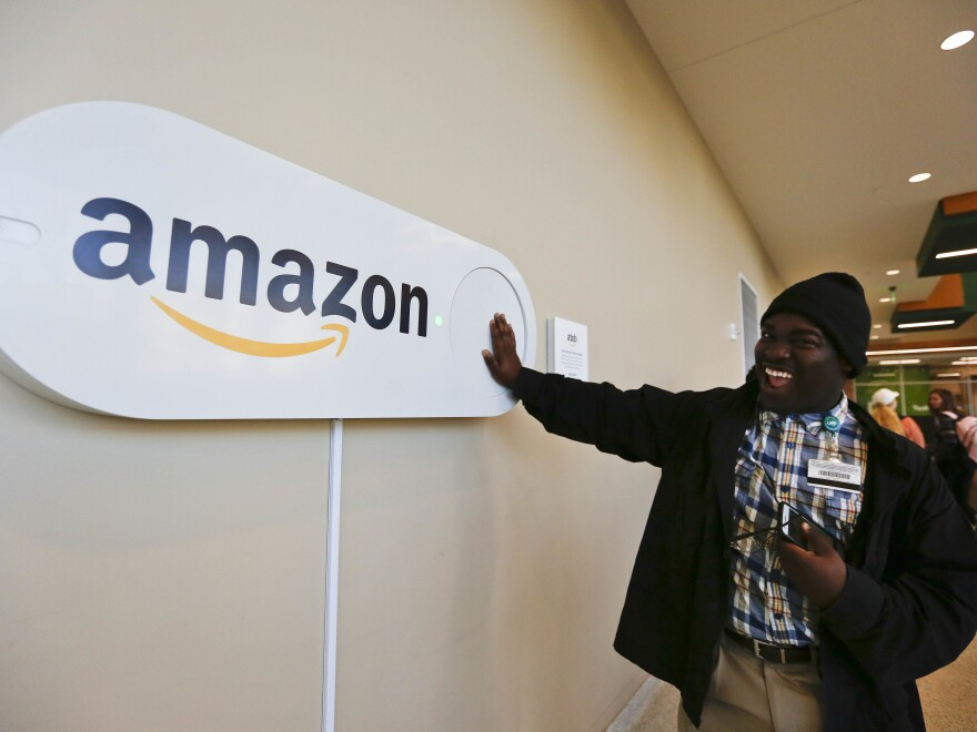 Zavian Tate, a student at the University of Alabama at Birmingham, pushes a large Amazon Dash button, part of the campaign to lure Amazon's second headquarters to the city.