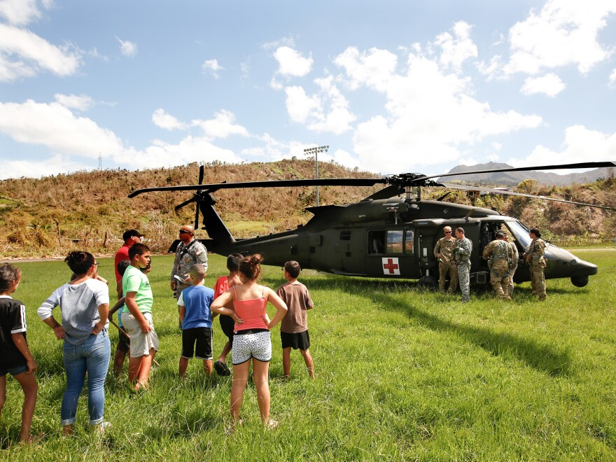 In the mountain town of Juyaya, Puerto Rico, last October, children watched as U.S. Army helicopters brought a team of physicians to assess the medical needs of the local hospital and residents. Going forward, health economists say, the U.S. territory will need continued federal help to deal with its overwhelming Medicaid expenses.